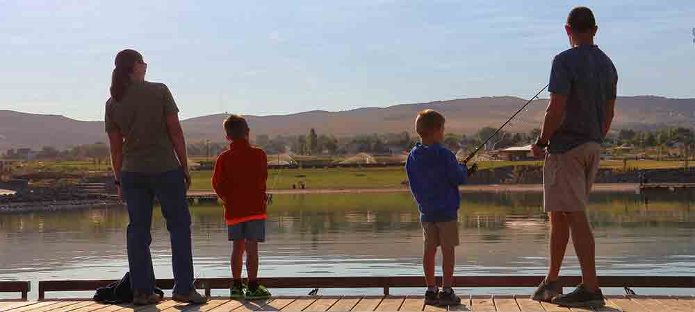 family fishing off dock at Portneuf Wellness Center