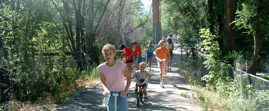 image: bikers and walkers on paved path